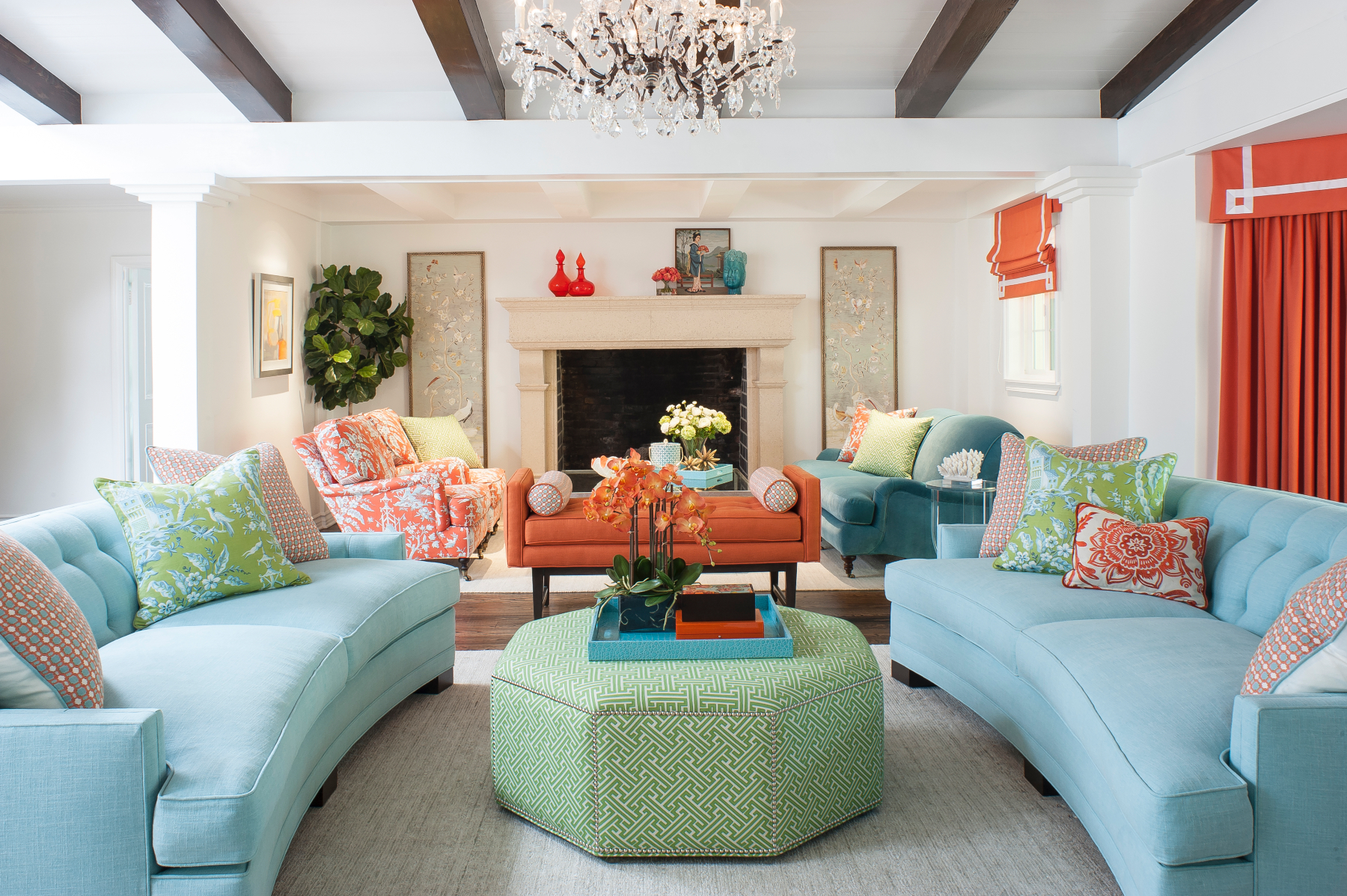 blue sofas and orange accents room
