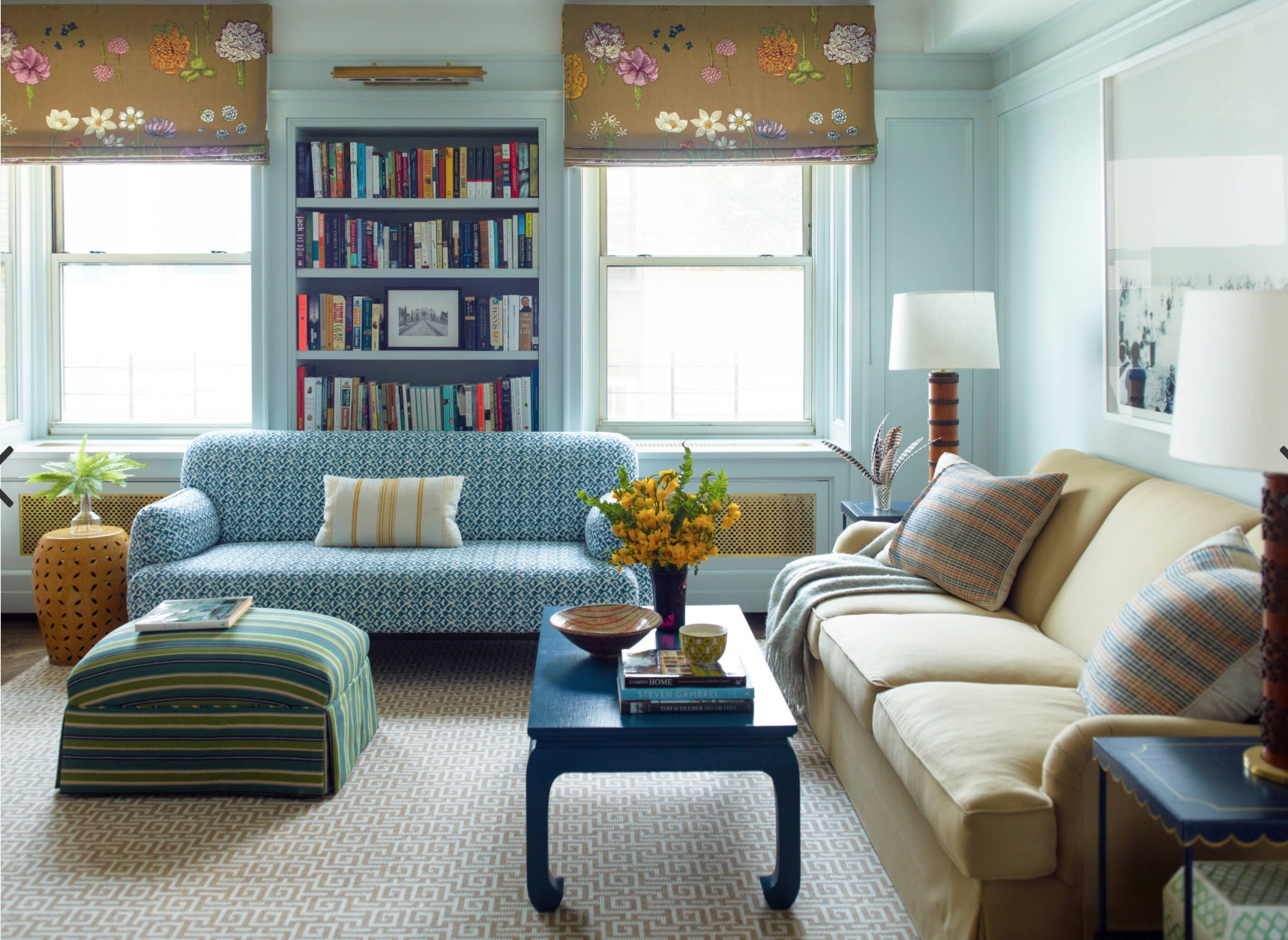 floral roman shades and light blue walls