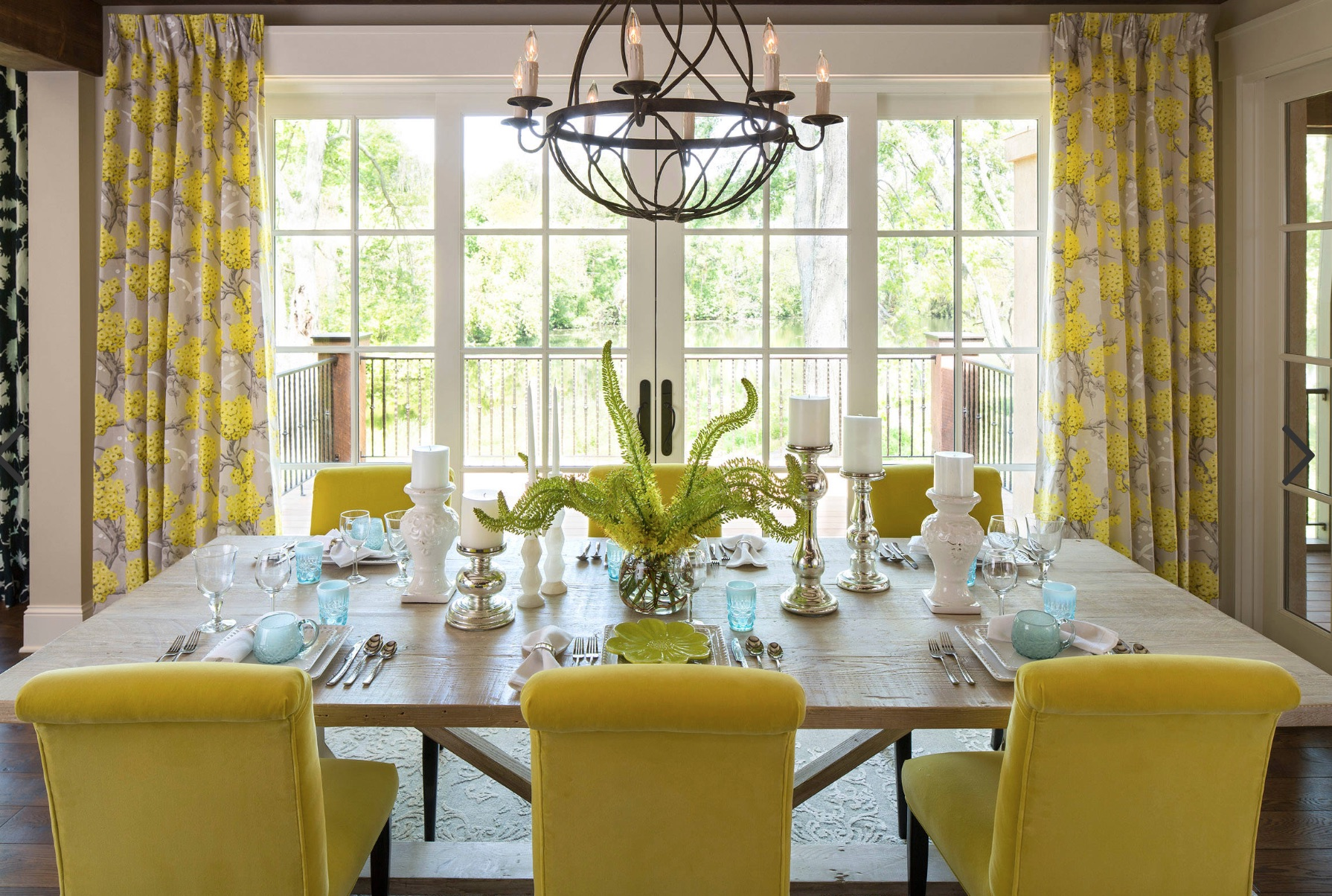 yellow dining chairs and yellow print window treatments